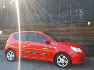 2010 Holden Barina TK MY11 Red 5 Speed Manual Hatchback.
