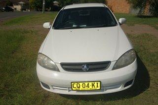 2006 Holden Viva JF White 4 Speed Automatic Hatchback.