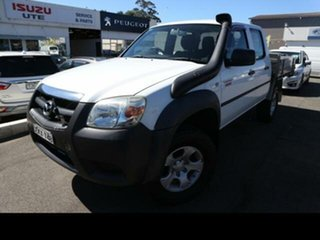 2009 Mazda BT-50 08 Upgrade B3000 DX (4x4) White 5 Speed Manual Dual Cab Chassis.