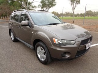 2010 Mitsubishi Outlander ZH MY11 LS 2WD Ironbark 5 Speed Manual Wagon.