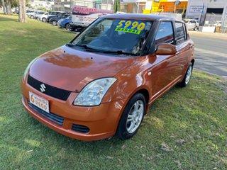 2005 Suzuki Swift RS415 Orange 5 Speed Manual Hatchback.