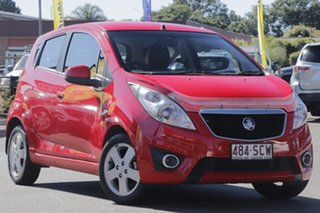 2011 Holden Barina Spark MJ MY11 CDX Chilli Red/leather 5 Speed Manual Hatchback.