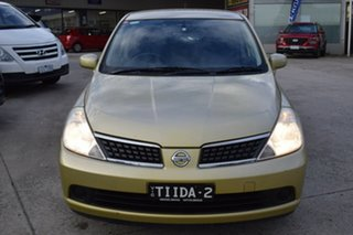 2006 Nissan Tiida C11 ST-L Yellow 4 Speed Automatic Hatchback.