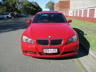 2007 BMW 3 Series E90 323i Steptronic Red 6 Speed Sports Automatic Sedan.
