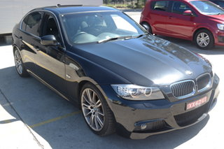 2011 BMW 3 Series E90 MY1011 323i Steptronic Lifestyle Black 6 Speed Sports Automatic Sedan.