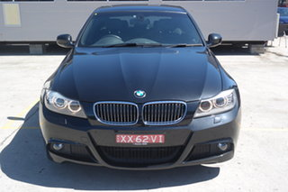 2011 BMW 3 Series E90 MY1011 323i Steptronic Lifestyle Black 6 Speed Sports Automatic Sedan.