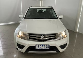 2015 Suzuki Grand Vitara JB Navigator 2WD White 4 Speed Automatic Wagon.