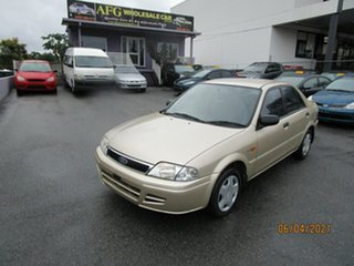 2001 Ford Laser KN LXI Gold 4 Speed Automatic Sedan.