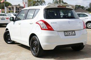 2011 Suzuki Swift FZ GL White 4 Speed Automatic Hatchback.