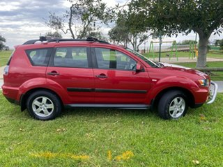 2010 Mitsubishi Outlander ZH MY11 LS 2WD Red 6 Speed Constant Variable Wagon.