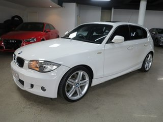 2010 BMW 1 Series E87 MY10 118d Steptronic Alpine White 6 Speed Sports Automatic Hatchback.