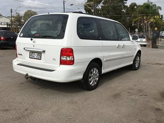 2005 Kia Carnival MY04 LS White 4 Speed Automatic Wagon.