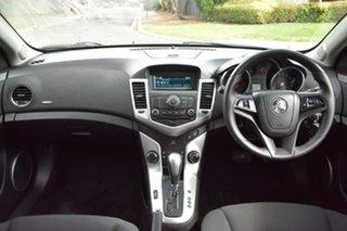 2011 Holden Cruze JG CD White 6 Speed Sports Automatic Sedan.