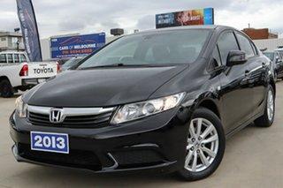2014 Honda Civic 9th Gen Ser II MY13 VTi-L Black 5 Speed Sports Automatic Sedan.