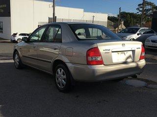 1999 Mazda 323 BJ Protege Gold 4 Speed Automatic Sedan.