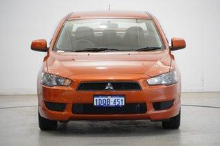 2011 Mitsubishi Lancer CJ MY11 ES Orange 5 Speed Manual Sedan.