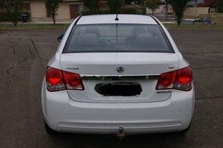 2011 Holden Cruze JH MY12 CD White 6 Speed Automatic Sedan.