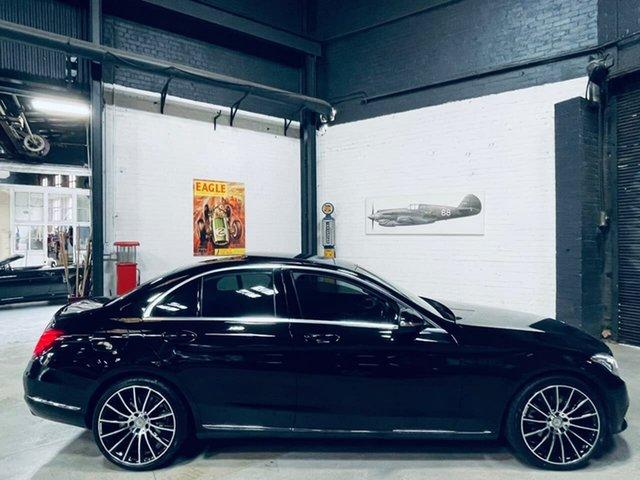 Used Mercedes-Benz C-Class W205 C200 7G-Tronic + Port Melbourne, 2014 Mercedes-Benz C-Class W205 C200 7G-Tronic + Black 7 Speed Sports Automatic Sedan
