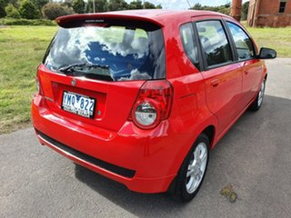 2010 Holden Barina TK Red Automatic Hatchback