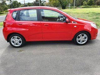 2010 Holden Barina TK Red Automatic Hatchback.