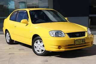 2003 Hyundai Accent LC MY03 GL Yellow 4 Speed Automatic Hatchback.