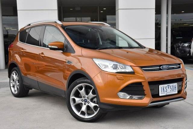 Used Ford Kuga TF MY16.5 Titanium PwrShift AWD Oakleigh, 2016 Ford Kuga TF MY16.5 Titanium PwrShift AWD Orange 6 Speed Sports Automatic Dual Clutch Wagon