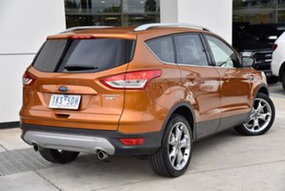 2016 Ford Kuga TF MY16.5 Titanium PwrShift AWD Orange 6 Speed Sports Automatic Dual Clutch Wagon.