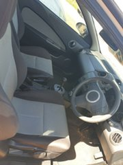 2011 Proton Satria-Neo White 5 Speed Manual Hatchback.