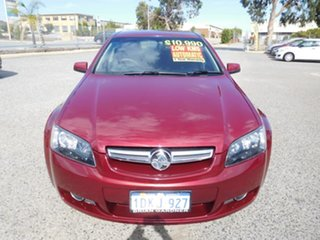 2009 Holden Berlina VE MY09.5 Red 4 Speed Automatic Sedan.