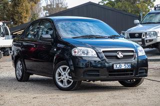 2009 Holden Barina TK MY10 Black 4 Speed Automatic Sedan.