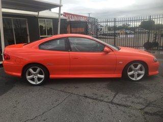 2002 Holden Monaro V2 CV8 Orange 6 Speed Manual Coupe.