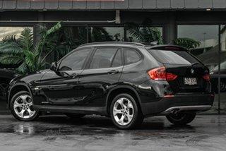 2010 BMW X1 E84 MY11 xDrive20d Steptronic Black 6 Speed Sports Automatic Wagon.