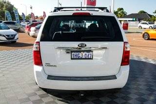 2010 Kia Grand Carnival VQ EXE White 5 Speed Sports Automatic Wagon.