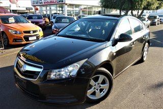 2010 Holden Cruze JG CD Black 6 Speed Sports Automatic Sedan.