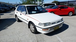 1991 Holden Nova LF GS White 4 Speed Automatic Hatchback.