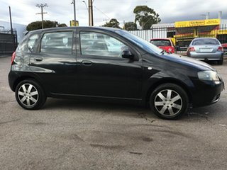 2006 Holden Barina TK Black 4 Speed Automatic Hatchback.