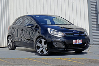 2012 Kia Rio UB MY12 SLi Black 6 Speed Sports Automatic Hatchback.