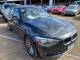 2014 BMW 1 Series F20 MY0713 118i Steptronic Black Sapphire 8 Speed Sports Automatic Hatchback.
