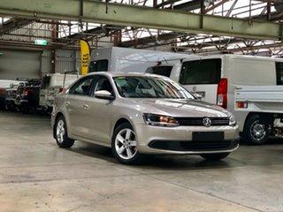2013 Volkswagen Jetta 1B MY13.5 118TSI DSG Gold/cloh 7 Speed Sports Automatic Dual Clutch Sedan.