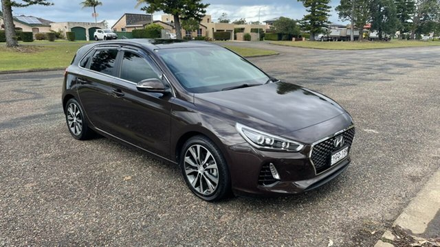 Used Hyundai i30 PD MY18 Premium D-CT Port Macquarie, 2017 Hyundai i30 PD MY18 Premium D-CT Bronze 7 Speed Sports Automatic Dual Clutch Hatchback