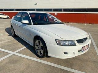 2004 Holden Commodore VZ Lumina White 4 Speed Automatic Sedan.