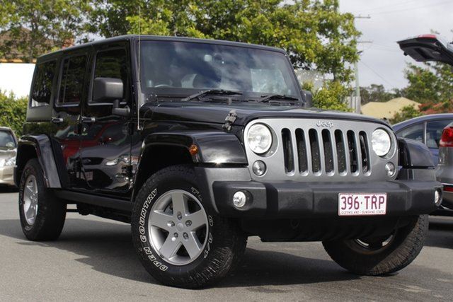 Used Jeep Wrangler JK MY2014 Unlimited Freedom Mount Gravatt, 2014 Jeep Wrangler JK MY2014 Unlimited Freedom Black 6 Speed Manual Softtop