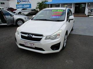 2013 Subaru Impreza White 6 Speed Manual Hatchback.