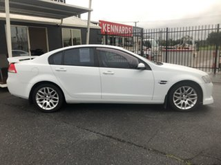 2009 Holden Commodore VE MY09.5 International White 4 Speed Automatic Sedan.