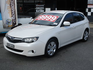 2010 Subaru Impreza MY10 R (AWD) Pearl White 4 Speed Automatic Hatchback.