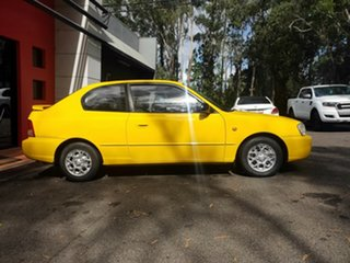 2000 Hyundai Accent LC GL Yellow 5 Speed Manual Hatchback.