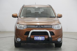 2013 Mitsubishi Outlander ZJ MY14 LS 4WD Orange 6 Speed Sports Automatic Wagon.