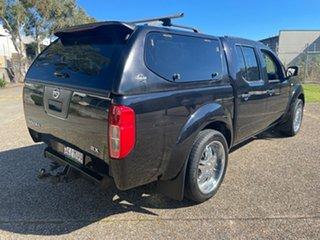 2011 Nissan Navara D40 MY11 RX (4x2) Black 6 Speed Manual Dual Cab Pick-up.