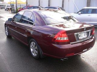 2003 Holden Calais VY Burgundy 4 Speed Automatic Sedan.