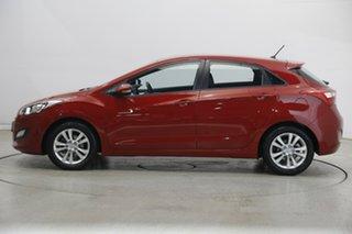 2014 Hyundai i30 GD2 MY14 Trophy Brilliant Red 6 Speed Sports Automatic Hatchback.